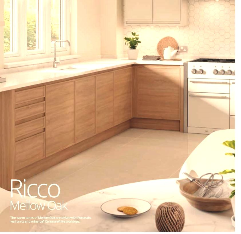 The warm tones of Mellow Oak are offset with Porcelain wall units and minerva® Carrara White worktops.